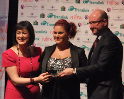 Levi being presented with award from BBC's Donna Traynor and event sponsor, Fujitsu's Account Director, David Clements.