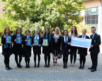 Academy presents charity cheque to Marie Curie NI